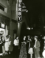 1936 Robert Cummings & Marsha Hunt signing autographs at the Brown Derby on Vine St.