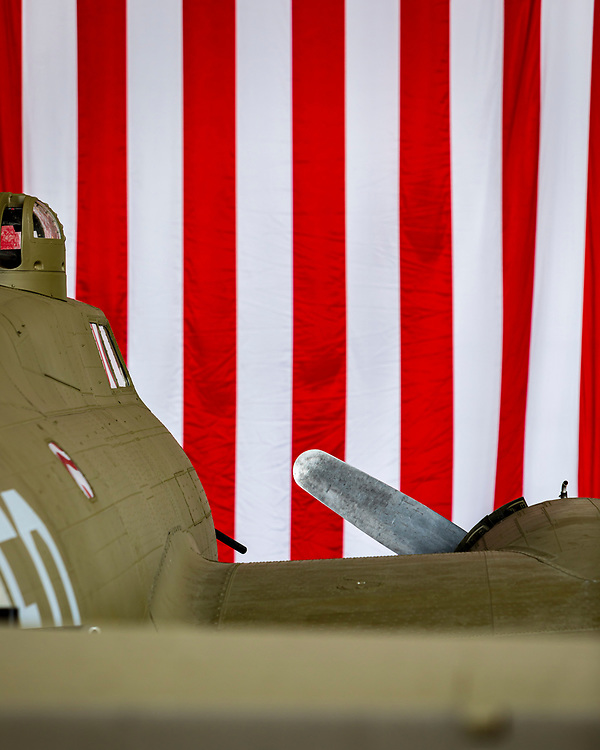A WWII B-17 bomber, photographed with the American flag in the background during the 2019 Veterans Day event at Delta Tech Ops at Atlanta's Hartsfield-Jackson International Airport.<br /> <br /> Created by aviation photographer John Slemp of Aerographs Aviation Photography. Clients include Goodyear Aviation Tires, Phillips 66 Aviation Fuels, Smithsonian Air & Space magazine, and The Lindbergh Foundation.  Specialising in high end commercial aviation photography and the supply of aviation stock photography for advertising, corporate, and editorial use.