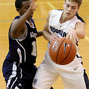 Hoggard's Jack Bagley passes around Millbrook's Andrew Evans. (Jason A. Frizzelle)