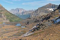 Boulder Pass, Mount Cleveland is in the far distance. Glacier National Park