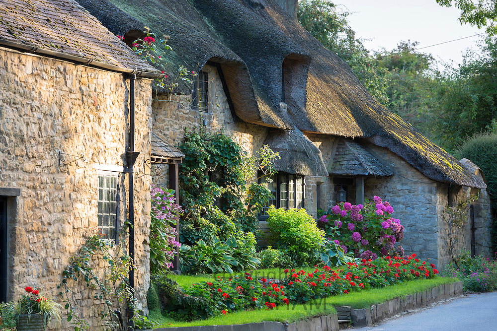 Quaint attractive traditional thatched country cottage at Broad Campden in the Cotswolds, Gloucestershire, England, UK
