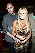 l to r: Aubrey O'Day and Guest at The 2009 Fall Baby Phat Fashion Show held at Gotham Hall on February 17, 2009 in New York City.
