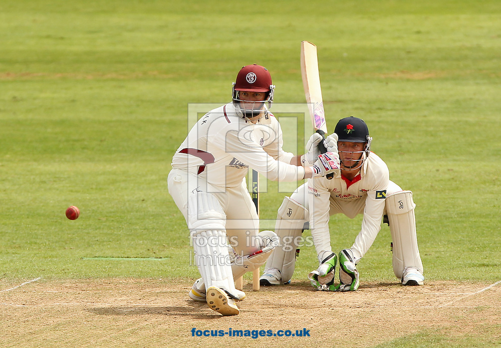 Marcus Trescothick (left) of Somerset County Cricket Club bats as Jos Buttler (right) of Lancashire County Cricket Club looks on during the LV County Championship Div One match at the County Ground, Taunton, Taunton<br /> Picture by Tom Smith/Focus Images Ltd 07545141164<br /> 29/06/2014