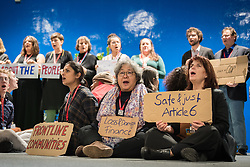 13 December 2019, Madrid, Spain: People gather for a sit-in demonstration at COP25, to claim space for a range a groups whose voices are not often listened to in the space of global climate negotiations: youth, women, frontline communities, indigenous communities.