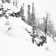 Andrew Whiteford skis blower storm powder in the backcountry of the Tetons.