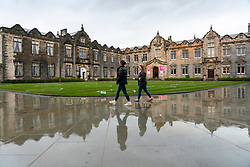 St Andrews, Scotland, UK. 30 September, 2020. Students in halls of residence at St Andrews University have been told that they can leave for home without financial penalty. The Scottish Government controversially told students in Scotland  to self-isolate in their rooms following localised outbreaks of Covid-19 amongst students.. Pictured; Students walk inside St Salvator's Quad. Iain Masterton/Alamy Live News
