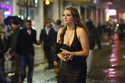 © licensed to London News Pictures. London, UK 01/01/2014. Revellers in Soho, London celebrating the New Year at the first hours of 2014. Photo credit: Tolga Akmen/LNP
