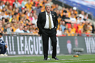Steve Bruce, the Hull City manager looks on from the touchline. Skybet football league Championship play off final match, Hull city v Sheffield Wednesday at Wembley Stadium in London on Saturday 28th May 2016.<br /> pic by John Patrick Fletcher, Andrew Orchard sports photography.