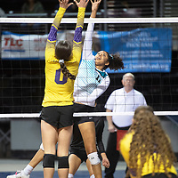 Navajo Prep's Hailey Martin (11) tips the ball at the net against Tucumcari Friday morning at the Santa Ana Star Center in the NMAA Class 3A State Volleyball tournament in Rio Rancho.
