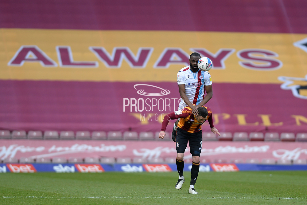 Scunthorpe United Emannuel Onariase (6) defending during the EFL Sky Bet League 2 match between Bradford City and Scunthorpe United at the Utilita Energy Stadium, Bradford, England on 1 May 2021.