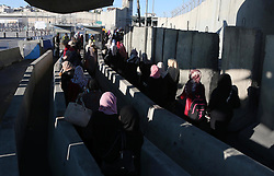 June 16, 2017 - Ramallah, West Bank, Palestinian Territory - Palestinians make their way through the Israeli Qalandia checkpoint, in the occupied West Bank between Ramallah and Jerusalem, to attend Friday prayer of the holy fasting month of Ramadan in Jerusalem's al-Aqsa mosque, on June 16, 2017  (Credit Image: © Prime Minister Office/APA Images via ZUMA Wire)