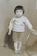 full length little Japanese girl in western style knitted clothing 1950s