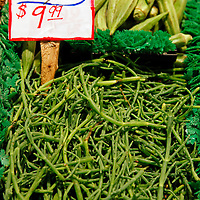 USA, Washington, Seattle. Local Sea Beans for sale at Pike Place Market.