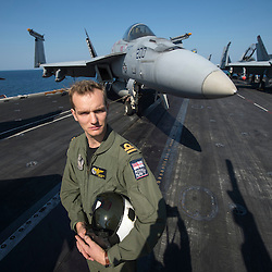 USS John C Stennis CVN-74 Aircraft Carrier.Pic Shows F-18 Super Hornet Pilot Stephen Collins with call sign Lothar( Loser of the American Revolution) and Royal Navy Pilot on secondment to the US Navy