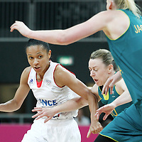 30 July 2012: Edwige Lawson-Wade of France drives past Kristi Harrower of Australia during the 74-70 Team France overtime victory over Team Australia, during the women's basketball preliminary, at the Basketball Arena, in London, Great Britain.
