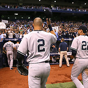 New York Yankees shortstop Derek Jeter (2) tips his hat to the crowd after a 3-2 victory and his final scheduled game against the Tampa Bay Rays at Tropicana Field on Thursday, Sept. 17, 2014 in St. Petersburg, Florida. (AP Photo/Alex Menendez)