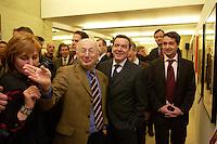 """14 FEB 2005, BERLIN/GERMANY:<br /> Stefan Aust, Chefredaktuer Der Spiegel, Gerhard Schroeder, SPD, Bundeskanzler, Gabor Steingart, Leiter Hauptstadtbuero Der Spiegel, (v.L.n.R.), in der  Ausstellung """"Die Kunst des Spiegel"""", C/O Berlin, The Cultural Forum for Photography<br /> IMAGE:20050214-02-025<br /> KEYWORDS: Titelbilder, Gerhard Schröder"""