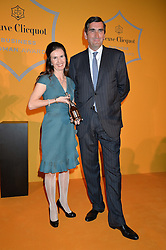 KATHERINE GARRETT-COX winner of the Veuve Clicquot Business Woman of The Year andJEAN-MARC GALLOT at the Veuve Clicquot Business Woman Awards held at Claridge's, Brook Street, London on 11th May 2015.