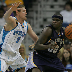 Jan 20, 2010; New Orleans, LA, USA; Memphis Grizzlies forward Zach Randolph (50) drives in against New Orleans Hornets forward Darius Songaila (9) during the second half at the New Orleans Arena. The Hornets defeated the Grizzlies 113-111. Mandatory Credit: Derick E. Hingle-US PRESSWIRE