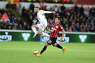 Ashley Richards of Swansea city is challenged by Eduardo Vargas of QPR. Barclays Premier league match, Swansea city v Queens Park Rangers at the Liberty stadium in Swansea, South Wales on Tuesday 2nd December 2014<br /> pic by Andrew Orchard, Andrew Orchard sports photography.