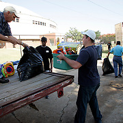 SHREVEPORT, LA - September 2, 2005:  Volunteers unload one trailer and load another with donated goods at the Hirsch Memorial Colliseum in Shreveport, LA. (Photo by Todd Bigelow/Aurora)