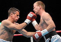 Local D.J., Jeremy Lyons, on the left, competes in his first professional match as a fundraiser for a local charity. Lyons was knocked out in the 2nd round.