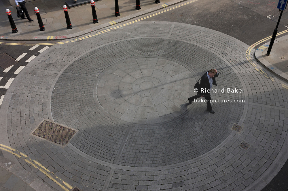 Aerial view of a city pedestrian crossing the circles of a City of London roundabout