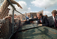 .Jimmy Carter shakes hands with a crowd in Virginia in November 1976..Photo by Dennis Brack