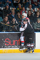 KELOWNA, CANADA - FEBRUARY 10: Owen Hardy #15 of the Vancouver Giants checks Leif Mattson #28 of the Kelowna Rockets into the boards on February 10, 2017 at Prospera Place in Kelowna, British Columbia, Canada.  (Photo by Marissa Baecker/Shoot the Breeze)  *** Local Caption ***