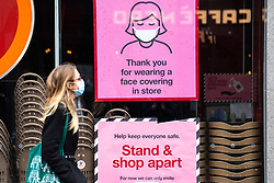 Glasgow, Scotland, UK.1 December 2020. Coronavirus health warnings, shop display and graffiti in Glasgow city centre.  Iain Masterton/Alamy Live News