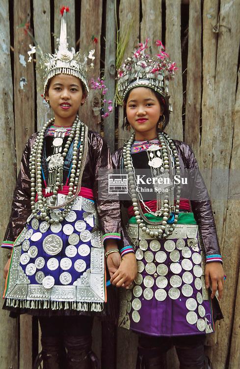 Dong girls in traditional costume, Guizhou, China