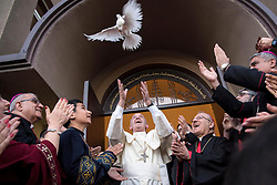 Pope Francis releases a dove as a symbol of peace during a meeting with Chaldean community at the Catholic Church of St Simon Bar Sabbae in Tbilisi, Gerogia on September 30, 2016 on the first day of a three-day trip to the Caucasus.The head of the Catholic Church was invited to the ex-Soviet Republic by his counterpart in the Georgian Orthodox Church, Patriarch Ilia II. Photo by ABACAPRESS.COM