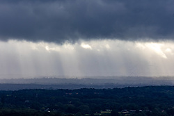 Licensed to London News Pictures. 27/09/2021. Dorking, UK. Dark rain clouds over Surrey near Dorking this morning as weather forecasters predict rain and wind for this week with temperatures not much above 16c. Photo credit: Alex Lentati/LNP