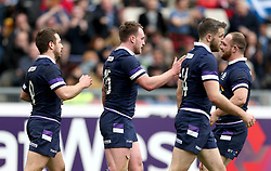 Scotland's Stuart Hogg (second left) celebrates after scoring his side's fourth try during the NatWest 6 Nations match at the Stadio Olimpico, Rome.