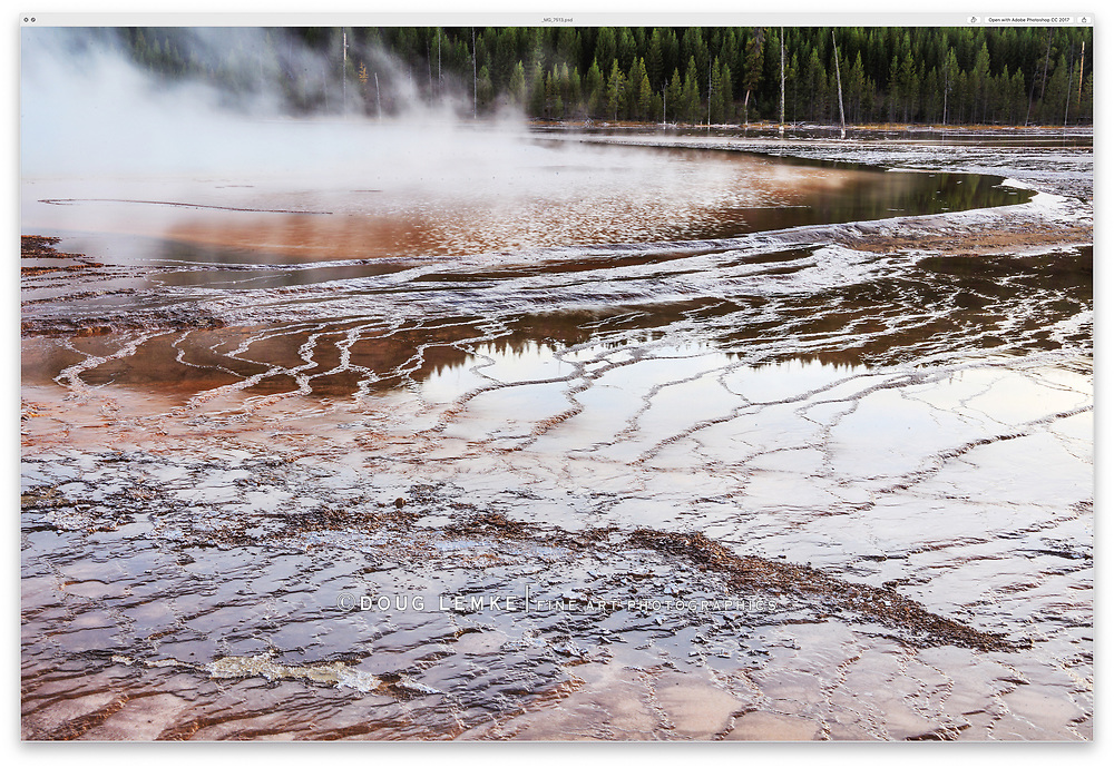 Steam rising from the Grand Prismatic Spring at the The Midway Geyser Basin, Yellowstone National Park, Wyoming, USA
