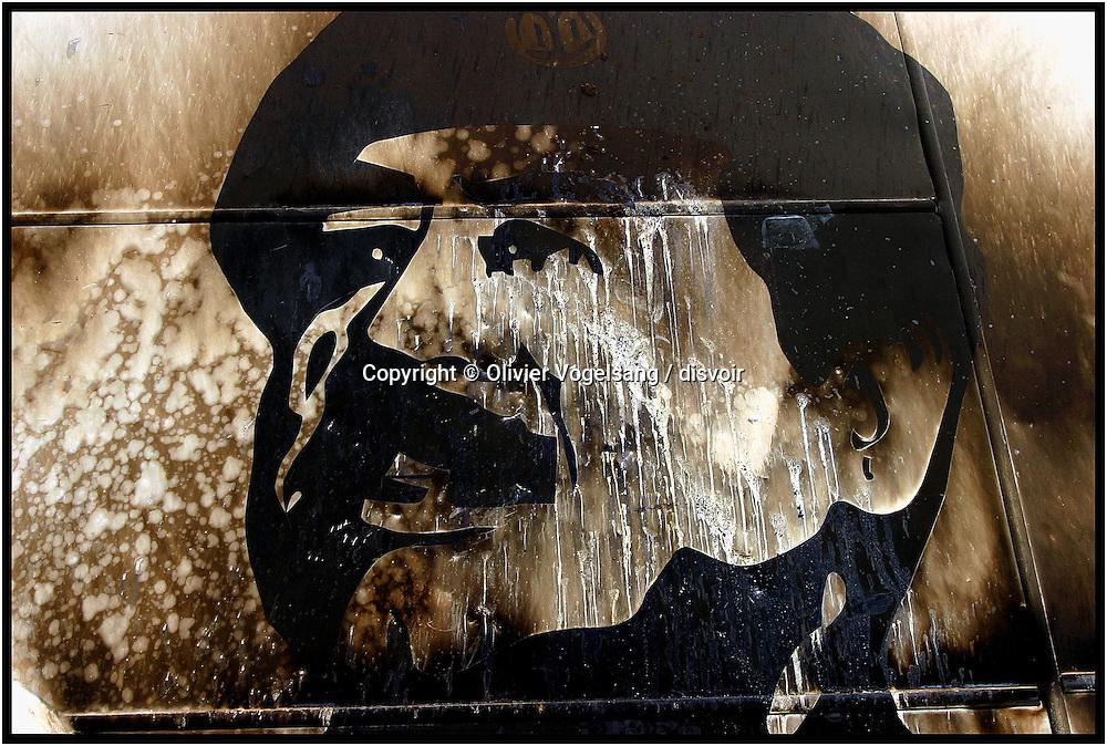 Iraq. Baghdad. Saddam Hussein portrait burnt in city center.