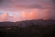 Landscape view at sunset looking along the mountains and countryside towards the West coast on 10th September 2017 in Marignana, Corsica, France. Corsica is an island in the Mediterranean and one of the 18 regions of France. It is located southeast of the French mainland and west of the Italian Peninsula.