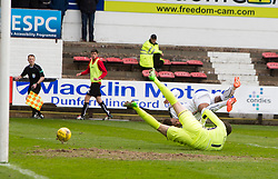 Dunfermline's Sean Murdoch brings down Falkirk's Myles Hippolyte for a penalty. Dunfermline 1 v 2 Falkirk, Scottish Championship game played 22/4/2017 at Dunfermline's home ground, East End Park.