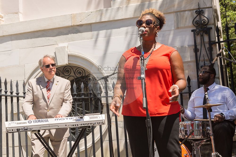 The new Charleston Mayor John Tecklenburg plays they keyboards as he joins in the fun during the kick off for the annual Spoleto Festival USA, a 17-day performing arts festival May 27, 2016 in Charleston, South Carolina.