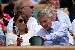 Carole and Michael Middleton in the royal box of centre court on day four of the Wimbledon Championships at The All England Lawn Tennis and Croquet Club, Wimbledon.