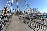 A general view of the city of London from the Golden Jubilee Bridge looking towards nearly empty Bridge, Wednesday, March 25, 2020. British lawmakers voted to shut down Parliament for 4 weeks, due to the coronavirus outbreak. The new coronavirus causes mild or moderate symptoms for most people, but for some, especially older adults and people with existing health problems, it can cause more severe illness or death. (Photo/Vudi Xhymshiti)
