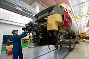 A worker assemble a Pendolino train for Virgin at the Alstom Ferroviaria SPA factory in Savigliano, Italy, on Friday, Feb. 11, 2011. Photographer: Victor Sokolowicz/Bloomberg