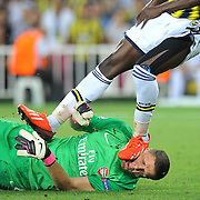 Fenerbahce's Moussa Sow and Arsenal's goalkeeper Wojciech Szczesny during the UEFA Champions League Play-Offs First leg soccer match Fenerbahce between Arsenal at Sukru Saracaoglu stadium in Istanbul Turkey on Wednesday 21 August 2013. Photo by TURKPIX