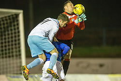 Cowdenbeath's keeper David McGurnand Forfar Athletic's Danny Denholm. Cowdenbeath 3 v 4 Forfar Athletic, Scottish Football League Division Two game played 17/12/2016 at Central Park.