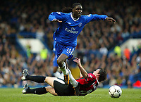 Photograph: Scott Heavey, Digitalsport, Chelsea v Manchester City. FA BArclaycard Premiership. 25/10/2003.<br /> Mario Melchiot skips over the tackle from Robbie Fowler.