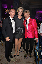 Left to right, SIR CLIFF RICHARD and SIR ROD STEWART and LADY STEWART at the annual PINKTOBER Gala presented by Hard Rock Heals at The Dorchester, Park Lane, London on 14th October 2016.  The annual event raises money for The Caron Keating Foundation.