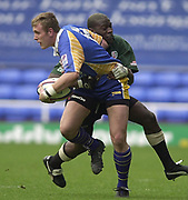 Reading, Berkshire, 20th April 2003,  ZURICH PREMIERSHIP RUGBY, The Madejski Stadium,  [Mandatory Credit: Peter Spurrier/Intersport Images],<br /> <br /> Zurich Premiership Rugby London Irish v Leeds<br /> Leeds Chris Hall look's for support after by tackles by Exiles Paul Sackey.