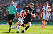 Stoke city's Joe Allen and Liverpool's Ben Woodburn in action.  Premier league match, Stoke City v Liverpool at the Bet365 Stadium in Stoke on Trent, Staffs on Saturday 8th April 2017.<br /> pic by Bradley Collyer, Andrew Orchard sports photography.