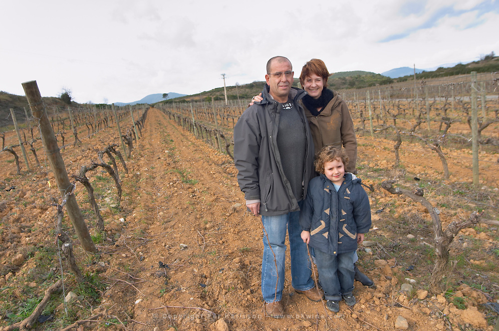 Marc and Sophie Valette with their son Camille Domaine de Canet-Valette Cessenon-sur-Orb St Chinian. Languedoc. Vines trained in Cordon royat pruning. Owner winemaker. The vineyard. France. Europe.