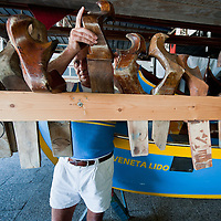 """VENICE, ITALY - SEPTEMBER 04:  A member of the Voga Veneta Lido rowing club chooses a """"forcola"""" during preparations  ahead of Sunday Historic Regata on September 4, 2010 in Venice, Italy. The Historic Regata is the most exciting rowing race on the Gran Canal for the locals and one of the most spectacular ***Agreed Fee's Apply To All Image Use***.Marco Secchi /Xianpix. tel +44 (0) 207 1939846. e-mail ms@msecchi.com .www.marcosecchi.com"""